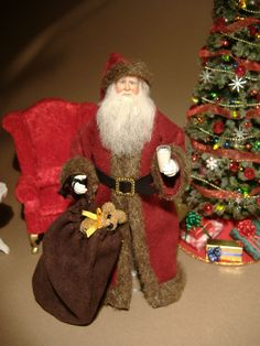 Miniature 1:12 scale Santa doll made by Karin Smead.
