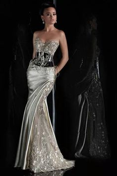 Modern silver gown with embellished bodice and matching side panels on gown, and silver metal belt