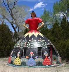 This 18-foot tall dome home was built by artist Bev Magennis. It's located in remote Apache Creek, New Mexico and serves as a tiny guest space on a larger 10-arce homestead. The entire exterior is covered with mosaic ceramic tile