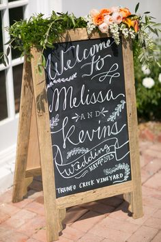chalkboard sign with flowers // photo by Chris + Jenn Photography // styling by Styling Starts Here // view more: http://ruffledblog.com/romantic-agoura-hills-wedding