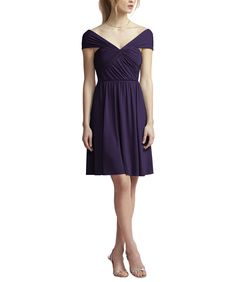 DescriptionJenny Yoo by Dessy Style JY500Cocktaillength bridesmaid dressV-neck neckline with wide shoulder strapsNatural waistMaracaine jerseyAvailable in a full length version. Contact stylist@brideside.com for more details.