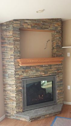 White Stone Fireplace With A Black Mantle In Place Of