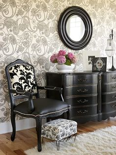 Black furniture against lovely wallpaper