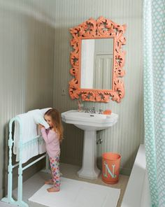 Wow that mirror is great! The color not my taste, but I like the impact it makes in the bathroom.