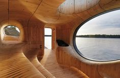 PARTISANS designed the gorgeous Grotto Sauna, a private sculpted space that boasts a stunning wooden interior and gorgeous views of Lake Huron.