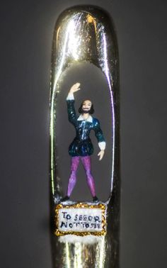 A microscopic sculpture of William Shakespeare by artist Willard Wigan which has been placed in the eye of a needle, to mark the 400th anniversary of his death