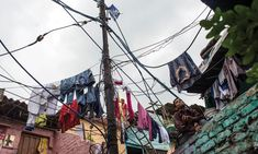 Clothes dry on power lines in a slum area in New Delhi...