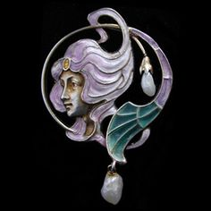 This is not contemporary - image from a gallery of vintage and/or antique objects. MEYLE & MAYER  An Art Nouveau, gilded silver, enamel and plique-a-jour brooch with pearl drops.
