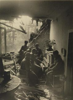 Russian soldiers playing piano in a wrecked living room in Berlin, 1945. By Dmitri Baltermants .