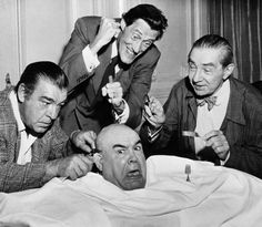 """Caption: 6/6/56-San Francisco, California: The three top horror actors in this country, (left to right), Lon Chaney, John Carradine, and Bela Lugosi stop off in San Francisco, June 6th, on a ballyhoo tour for their latest movie, """"The Black Sleep,"""" in time to have a snack for lunch. The """"snack"""" being served up is Tor Johnson, a wrestler known as the """"Swedish Angel,"""" who is also appearing in the movie."""