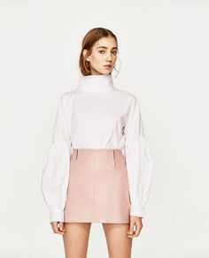 Image 2 of LEATHER EFFECT MINI SKIRT from Zara
