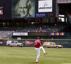 Thursday 20 June, 2002 -- Cardinals pitcher Darryl Kile warms up in the outfield as the hearse carrying Jack Buck's casket leaves the field before a game between the St. Louis Cardinals and the Anaheim Angels at Busch Stadium in St. Louis, Mo.