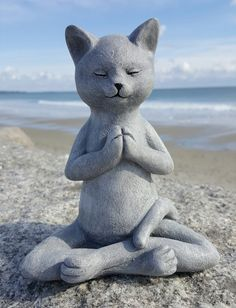 This sweet meditating cat is the ultimate representation of peacefulness and zen. Striking a perfect yoga prayer pose, she radiates tranquility. Add