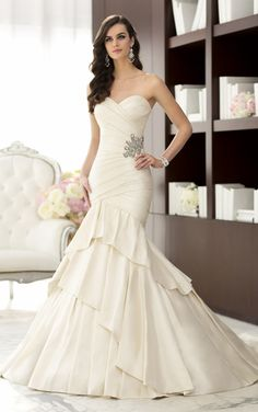 Layers and layers of Luxe Taffeta are the hallmark of this designer wedding dress by Essense of Australia (Style D1497)