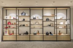A shelving unit created using the Qubo 25 P/L system. Includes adjustable shelves with underside lighting. Boutique Interior, Fashion Shop Interior, Shop Interior Design, Handbag Display, Shoe Display, Display Shelves, Shelving, Bag Store Display, Shoe Store Design