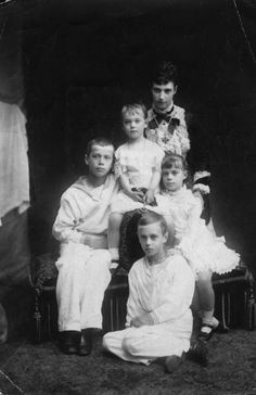 Tsarina Maria Feodorovna of Russia, nee Princess Dagmar of Denmark, with her children Tsarevich Nicholas (left), Grand Duke George (sitting on floor), Grand Duke Michael (sitting on Minnie's lap), and Grand Duchess Xenia (right)