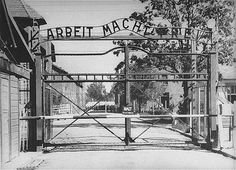 "Entrance to the main camp of Auschwitz. The gate bears the motto ""Arbeit Macht Frei"" (Work Makes One Free)."