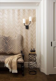 This foyer certainly features a plethora of different patterns and designs! The herringbone wallpaper is the perfect mute backdrop to the bold bronze light fixture. What do you think of the combination of patterns?