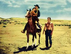 Natalie Wood, John Wayne and Jeffrey Hunter in a scene from the 1956 John Ford western 'The Searchers' John Wayne, Natalie Wood, Warner Bros Movies, Jeffrey Hunter, The Searchers, Circus Poster, Turner Classic Movies, John Ford, The Lone Ranger