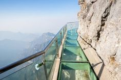 Zhangjiajie Grand Canyon Glass Bridge is the longest, highest glass-bottom bridge in China. Find out the ticket fee, how to get there and how to tour the glass bridge in Zhangjiajie. Zhangjiajie, Glass Walkway, Glass Bridge, Sky Bridge, In China, China Trip, China Travel, Parc National, Places