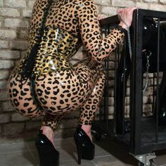 Girl wearing a Leopard print latex outfit