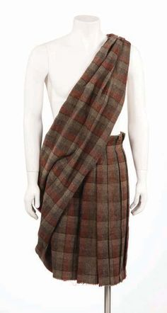 """William Wallaces Kilt. This is what a kilt originated from, as one piece of double width tartan 7 yards (yes, 21 ft) long. about 1/2 would be pleated, then rolled into around the waist and the excess thrown over the shoulder as a """"brat"""" and pinned or knotted."""