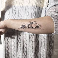 Small but pretty looking wave tattoo on the arm. There are three waves inked on the arm and they look beautifully symmetrical and perfect.