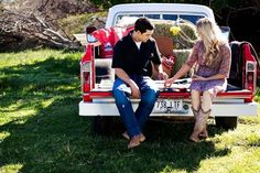 Are you two the epitome of every country song? For the bride and groom who love their cowboy boots and big trucks, find rustic engagement session ideas that speak to your country spirit. This couple chose to have a sweet picnic in the back of a truck.