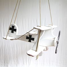 I would have loved this as a kid ... actually I would love it still :) // handmade wood airplane swing with painted design, built-in handgrips, wheels, and propeller