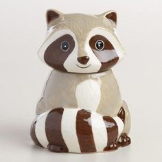 Our ceramic cookie jar is shaped and painted like an adorable raccoon, complete with a striped tail. This detailed woodland critter looks charming on a kitchen counter or tabletop and features an airt