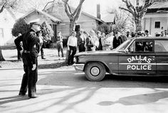 After 1:30 p.m,. Dallas police respond to the killing of Officer J.D. Tippit at the corner of 10th and Patton in Oak Cliff. Many officers controlling the crowd at the book depository heard the report of Tippit's shooting at 1:16 p.m. and began to search for the suspect.