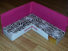 Make a sectional from cartons and duck tape.