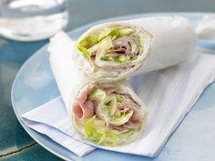Schinken-Wrap Hawaii mit Frischkäse: Leckere und dabei fett- und kalorienarme Alternative zu Würstchen oder Hamburger, die reichlich Vitamine liefert.