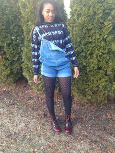 Thrifted sweater under overalls with tights and doc martens