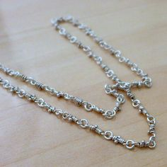 Bitsy hand crafted dainty chain. Delicate sterling silver linked necklace. Organic rustic Aroluna knots. It's part of the Knots line, the knots are handmade one by one, there's never two equal, every