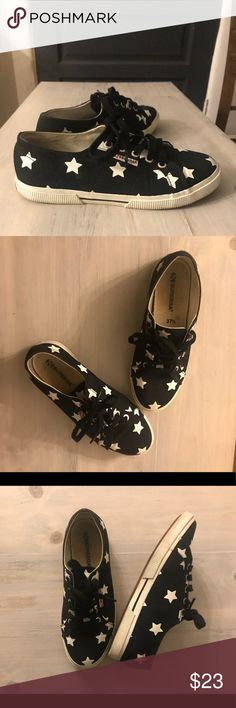 Black and white star power sneakers Worn once or twice, shoes normal signs of that. Still super cute! Superga Shoes Sneakers