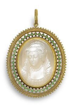 Circa 1865 gold, enamel, and moonstone cameo pendant, by Carlo Giuliano.  The oval moonstone cameo depicting an idealized portrait bust of Mary Queen of Scots, within a pierced gold frame of rope twist and beaded decoration, with green enamel inverted heart motifs and black enamel dots, maker's mark CG.