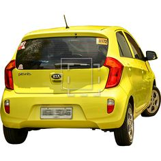 A yellow family car, parked and cut-out for use in architectural renderings.