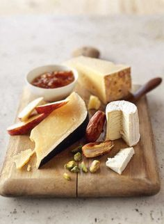"""Farmhouse Cheese Plate. Whether served as an hors d'oeuvre before dinner or as a sweet-savory treat after the meal, a cheese plate adds an elegant touch to any occasion. Stock your refrigerator with a few """"special occasion"""" cheeses, flavorful nuts and fresh, seasonal fruit, and you'll have an almost instant crowd-pleasing course. (Photo by Williams-Sonoma)"""