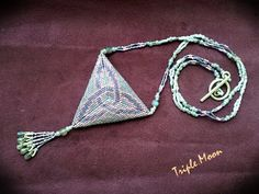 Triangle pendant with celtic pattern. Toho Treasure and labradorite round beads and drops.