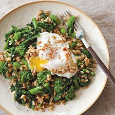 This salad is delicious for breakfast, lunch, or dinner. It's easy to make (particularly if you have cooked farro on hand), healthy, and satisfying. In place of the broccoli rabe, try roasted broccoli or cauliflower. Or prepare the salad without the eggs and add a handful of tiny cubes of aged or fresh pecorino.