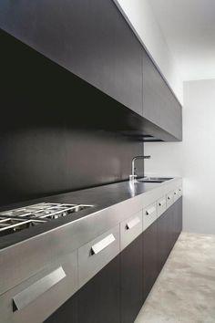 Dark brown kitchen unit with stylish zinc countertop