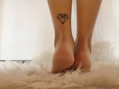 Polygon heart tattoo on Giulia Fabrizi.