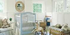 Custom chair and crib bumper in Jane Shelton ticking. Other bedding in linen by Ralph Lauren. Mirror, French horse tricycle and Orkney child's chair, all antiques. Vintage French hot-air balloon light fixture. Custom cotton dhurrie.