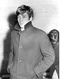 A photo of John with a very obvious  worried expression leaving Guildford hall shielding Paul  after he was sick with a throat infection just...look at...John's...face...I'm  Crying!!!  Big brother John. Try and tell me that they didn't love and care for one another <3