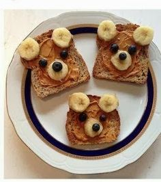 Teddy Bear Toast with peanut butter, banana, and blueberries