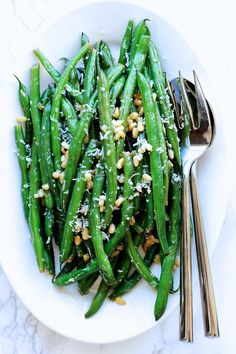 Green beans with parmesan and lemon butter sauce - a quick, easy, delicious way to serve green beans.  Green Valley Kitchen.