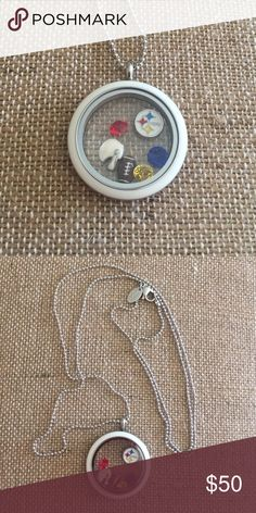 "NWT Origami Owl twist locket, 30"" chain, charms Origami Owl twist locket with white face and 30"" chain. Football, helmet, red/yellow/blue crystals and Pittsburgh Steelers charm. (Everything is Origami Owl EXCEPT Steelers charm.) Origami Owl Jewelry Necklaces"