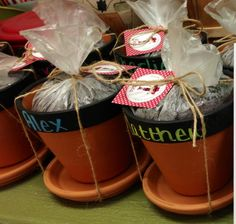 Flower pot favors for a cowgirl party. Painted the top of terra cotta pots with chalkboard paint and wrote each child's name with a chalk marker (which does not wash off in the rain). Bagged potting mix in plastic baggies and allowed the children to chose vegetable or flower seed packets to plant once they got home.
