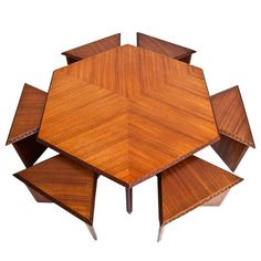 "Hexagonal Table with Six Stools by Frank Lloyd Wright USA 1955 Hexagonal Mahogany Coffee Table with Six Triangular Stools by Frank Lloyd Wright from the ""Taliesin Collection"" for Heritage-Henredon Stools: 14""h Table: 17.5""h"